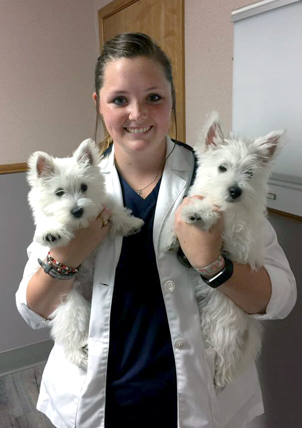 Dr O'Bannion Holding Two Dogs